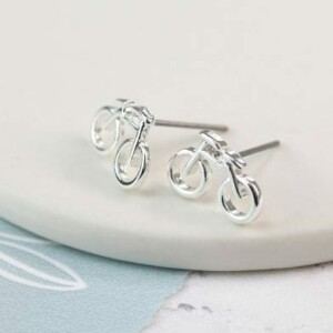 Silver plated stud earrings featuring a pair of little bicycles.